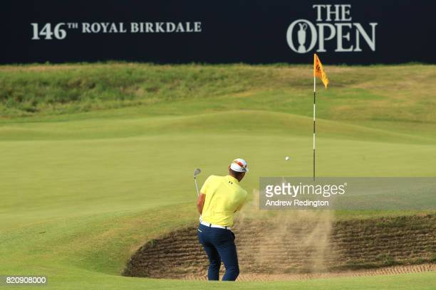 Chan Kim of the United States hits his third shot from a bunker on the 18th hole during the third round of the 146th Open Championship at Royal...