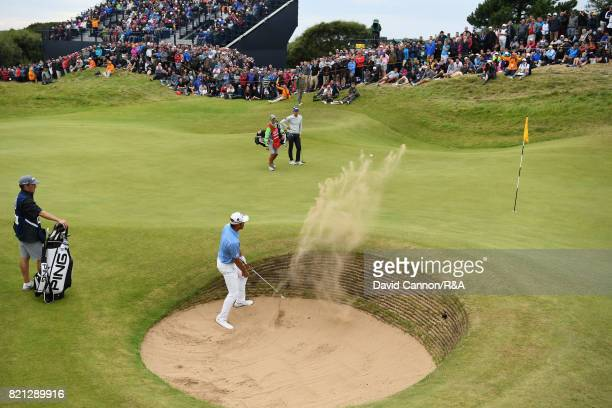 Chan Kim of the United States plays a bunker shot on the 17th hole during the final round of the 146th Open Championship at Royal Birkdale on July 23...