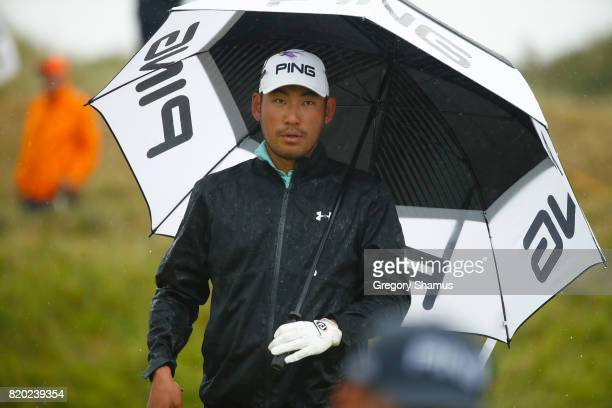 Chan Kim of the United States under an umbrella on the 7th green during the second round of the 146th Open Championship at Royal Birkdale on July 21...
