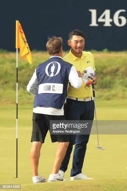 Chan Kim of the United States with his caddie on the 18th green during the third round of the 146th Open Championship at Royal Birkdale on July 22...
