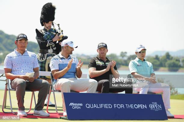 Chan Kim of the USA Michael Hendry of New Zealand Adam Bland of Australia and KyungTae Kim of South Korea looks on during the final round of Mizuno...