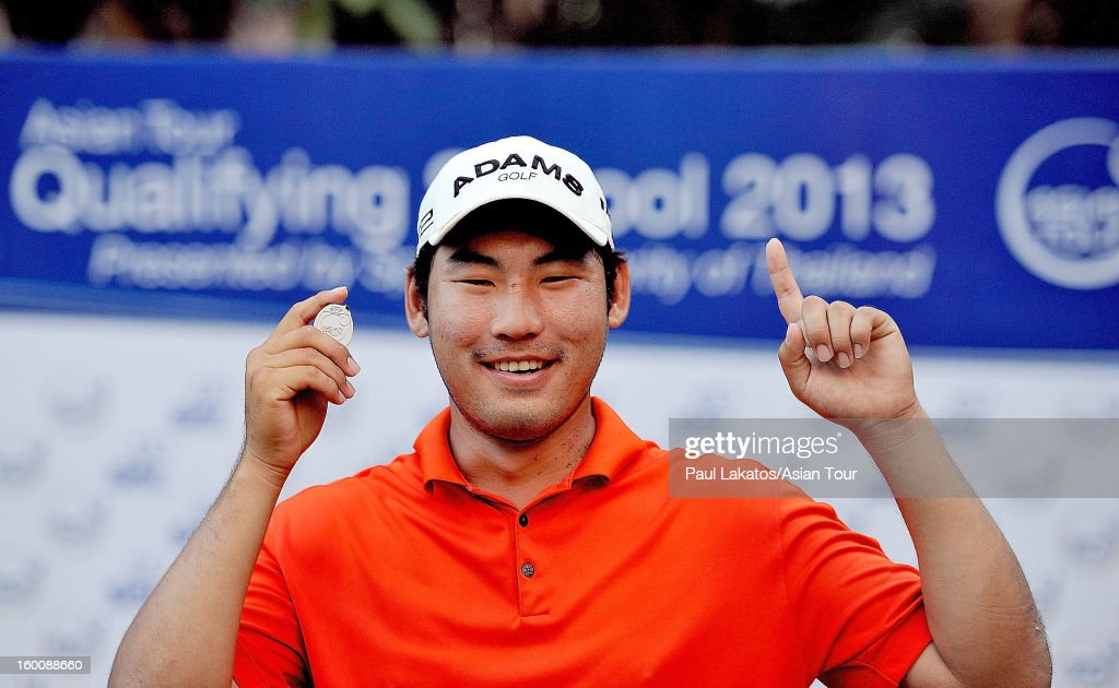 Chan Kim of USA, poses after winning the Asian Tour Qualifying final stage at Springfield Royal Country Club on January 26, 2013 in Hua Hin, Thailand.