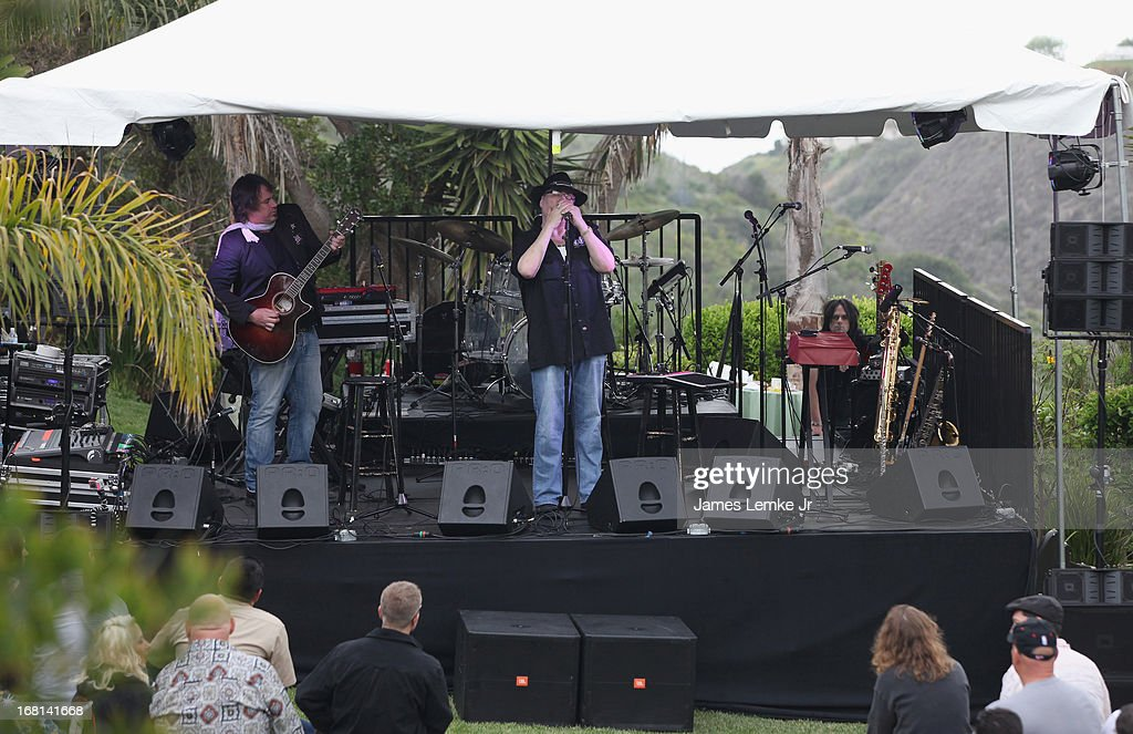 Chan Kinchla and <a gi-track='captionPersonalityLinkClicked' href=/galleries/search?phrase=John+Popper&family=editorial&specificpeople=1523132 ng-click='$event.stopPropagation()'>John Popper</a> attend Adam Carolla's Cinco De Mangria party Benefiting Children's Hospital Los Angeles on May 5, 2013 in Malibu, California.
