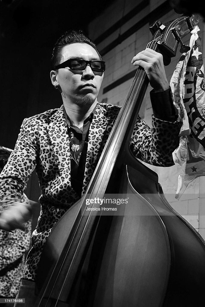 Chan Sze-chai, plays the double bass for the Hong Kong Rockabilly band ' The Boogie Playboys' during the Boogie Rockabilly Festival at the Fringe Club on July 20, 2013 in Hong Kong, Hong Kong.