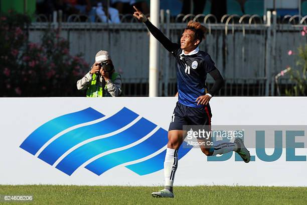 Chan Vathanaka of Cambodia celebrates after scoring during the final round Group B AFF Suzuki Cup match between Malaysia and Cambodia at the Thuwanna...