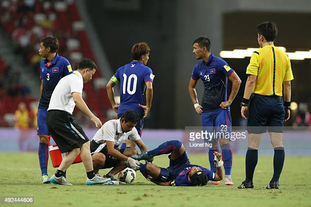 Chan Vathanaka of Cambodia goes down during the FIFA 2018 World Cup Qualifier match between Singapore and Cambodia at the National Stadium on October...