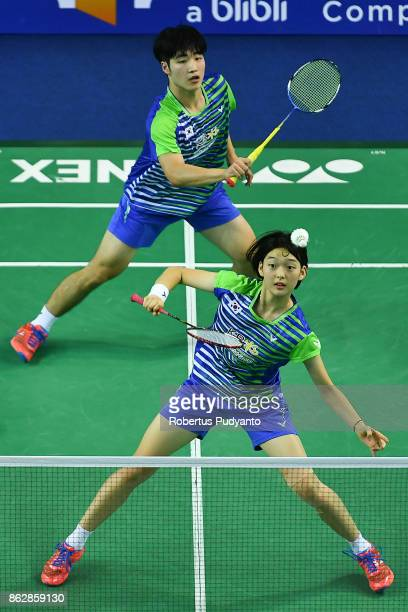 Chan Wang and Min Ji Kim of Korea compete against Jesper Toft and Alexandra Boje of Denmark during Mixed Doubles Round 32 match of the BWF World...