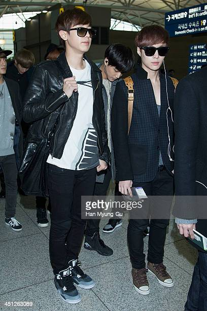 Chan Yeol and Lay of leading boy band EXO are seen on departure at Incheon International Airport on November 21 2013 in Incheon South Korea