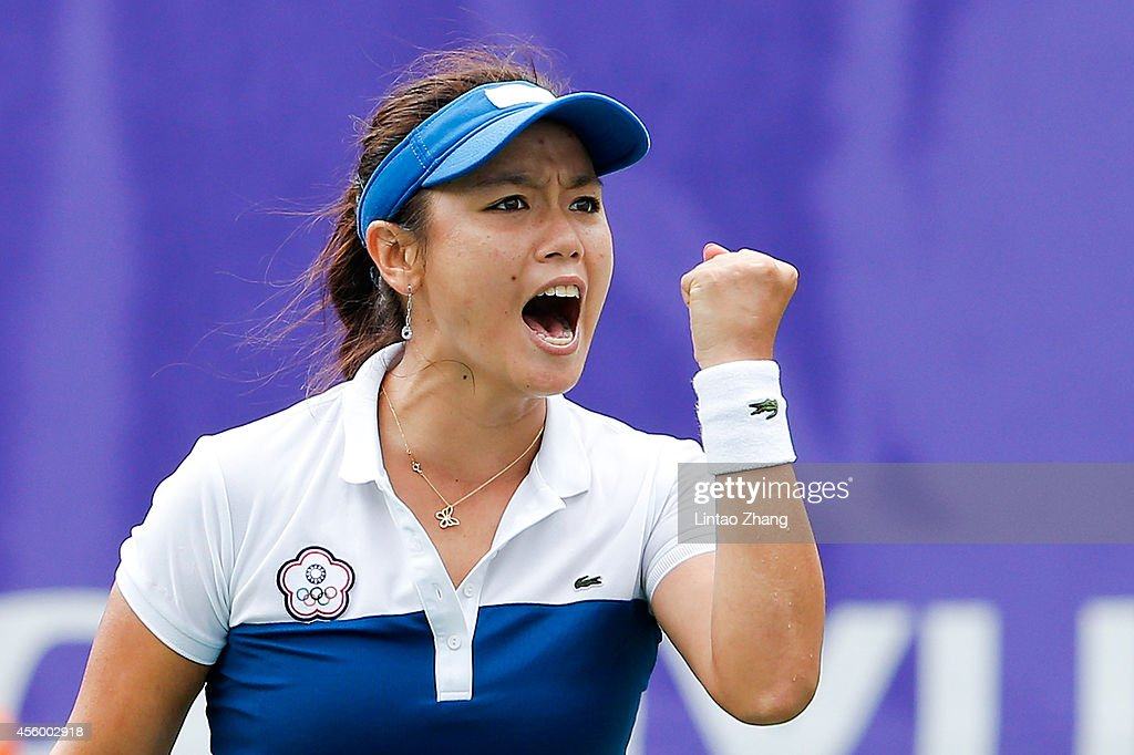 Chan Yung Jan of Chinese Taibei celebrates a point during the Women's Team Gold Medal Match against Duan Yingying of China on day five of the 2014...