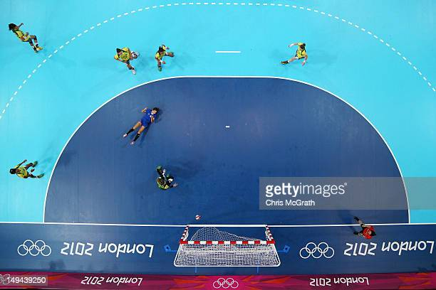 Chana Masson of Brazil blocks a shot in the Women's Handball preliminaries Group A Match 3 between Croatia and Brazil on Day 1 of the London 2012...