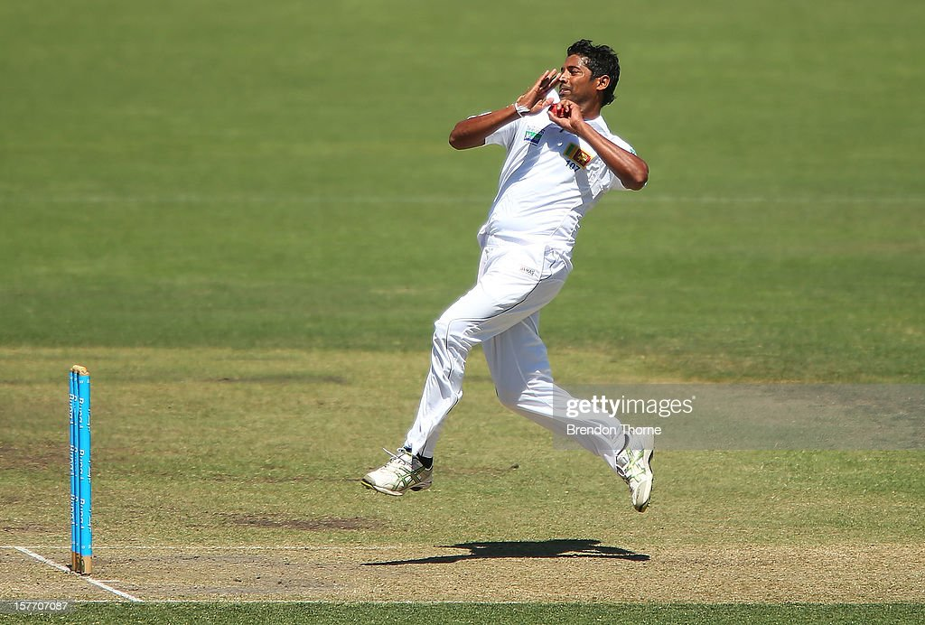 Chanaka Welagedara of Sri Lanka bowls during day one of the international tour match between the Chairman's XI and Sri Lanka at Manuka Oval on December 6, 2012 in Canberra, Australia.