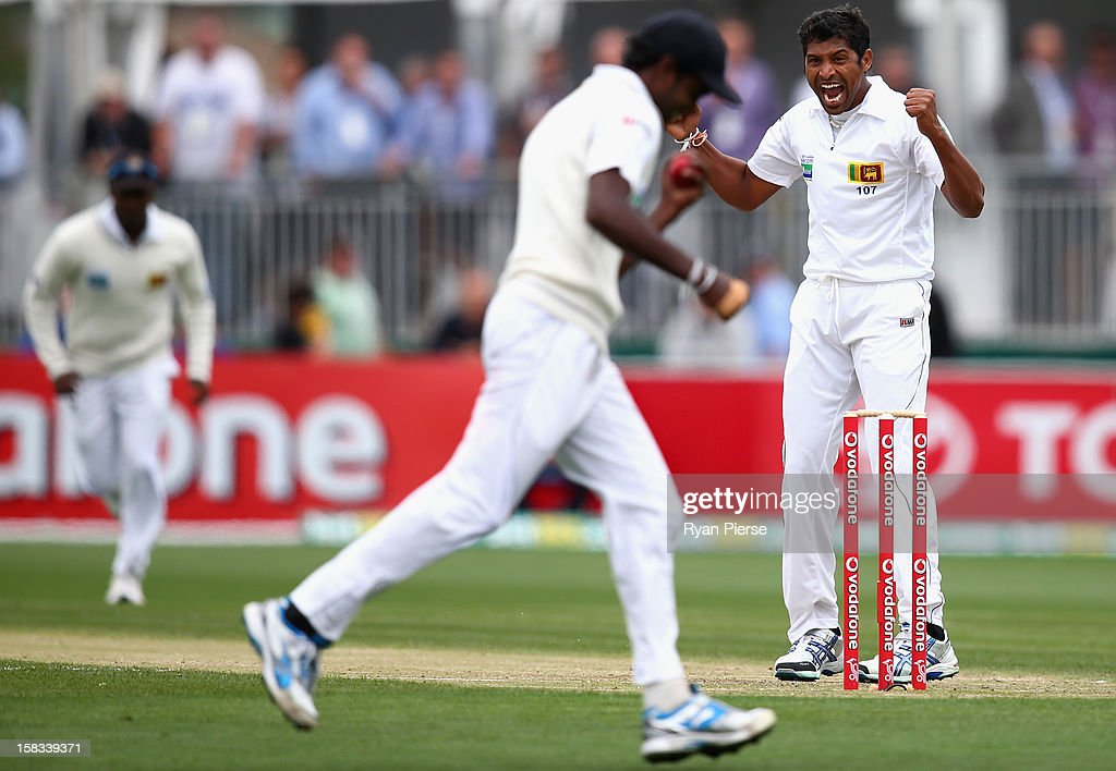Chanaka Welagedara of Sri Lanka celebrates after taking the wicket of Ed Cowan of Australia during day one of the First Test match between Australia and Sri Lanka at Blundstone Arena on December 14, 2012 in Hobart, Australia.