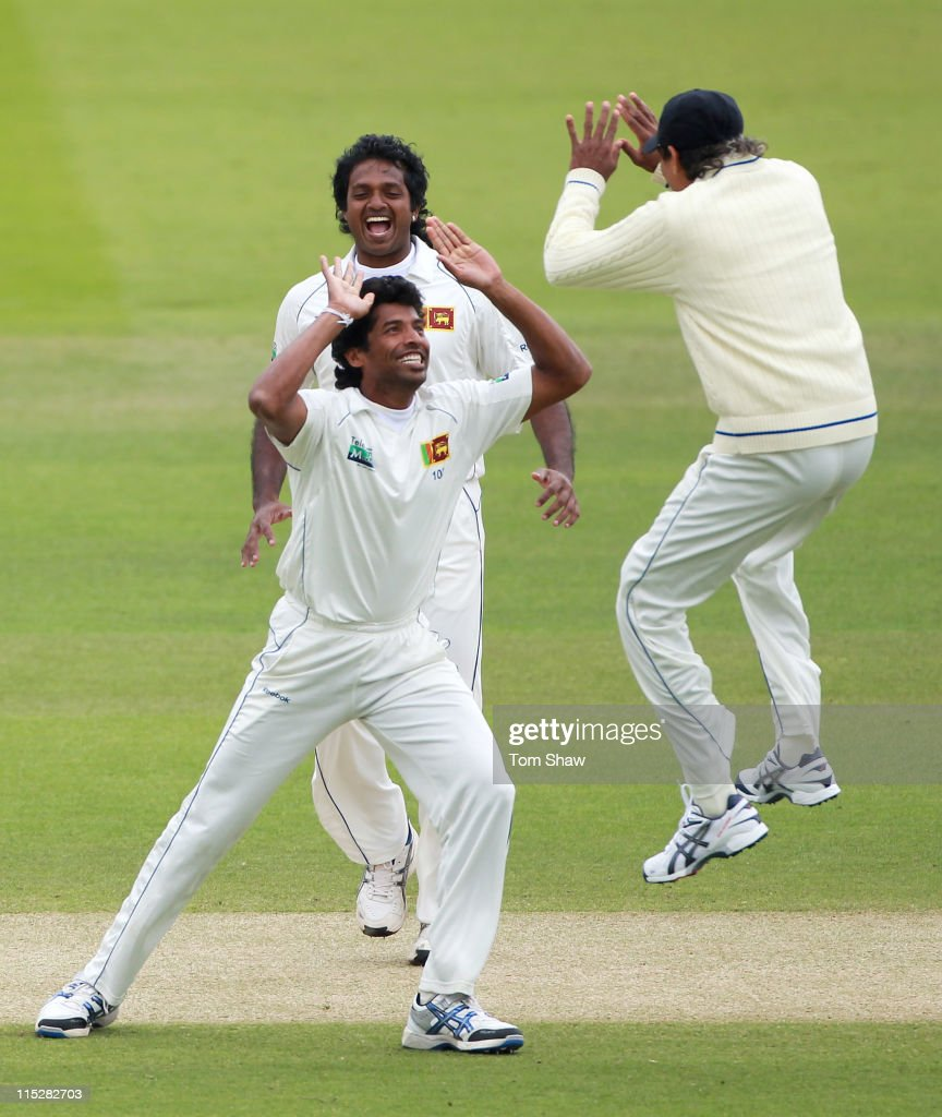 <a gi-track='captionPersonalityLinkClicked' href=/galleries/search?phrase=Chanaka+Welegedara&family=editorial&specificpeople=4436467 ng-click='$event.stopPropagation()'>Chanaka Welegedara</a> of Sri Lanka celebrates the wicket of Andrew Strauss of England with team mates during day four of the 2nd npower Test Match between England and Sri Lanka at Lord's Cricket Ground on June 6, 2011 in London, England.
