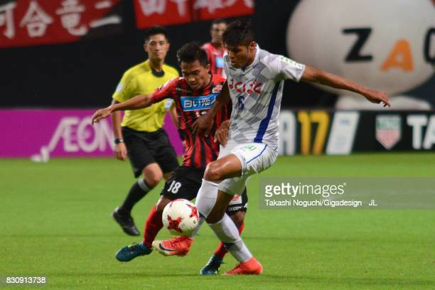 Chanathip Songkrasin of Consadole Sappporo and Eder Lima of Ventforet Kofu compete for the ball during the JLeague J1 match between Consadole Sapporo...