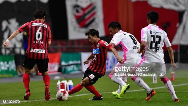 Chanathip Songkrasin of Consadole Sappporo and Masato Fujita of Sagan Tosu compete for the ball during the JLeague J1 match between Consadole Sapporo...