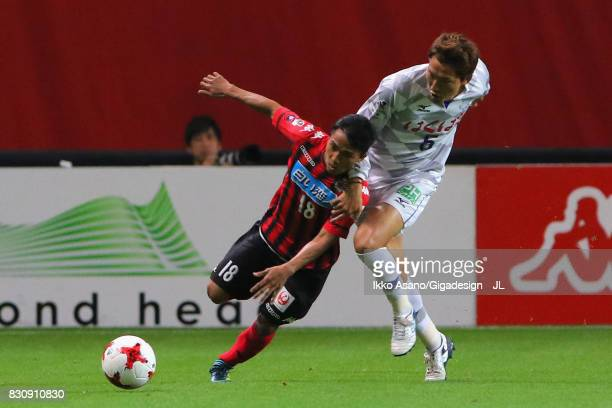 Chanathip Songkrasin of Consadole Sappporo and Ryo Shinzato of Ventforet Kofu compete for the ball during the JLeague J1 match between Consadole...