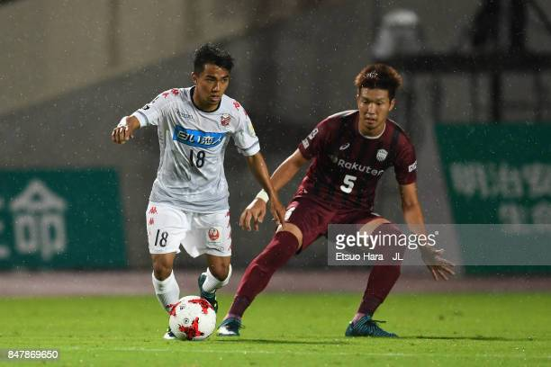 Chanathip Songkrasin of Consadole Sappporo and Takuya Iwanami of Vissel Kobe compete for the ball during the JLeague J1 match between Vissel Kobe and...