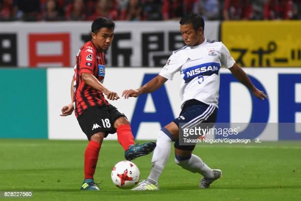 Chanathip Songkrasin of Consadole Sappporo and Takuya Kida of Yokohama FMarinos compete for the ball during the JLeague J1 match between Consadole...