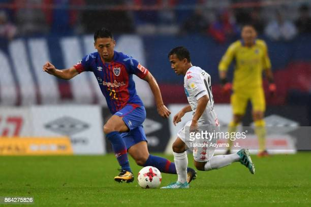 Chanathip Songkrasin of Consadole Sappporo and Yuhei Tokunaga of FC Tokyo compete for the ball during the JLeague J1 match between FC Tokyo and...