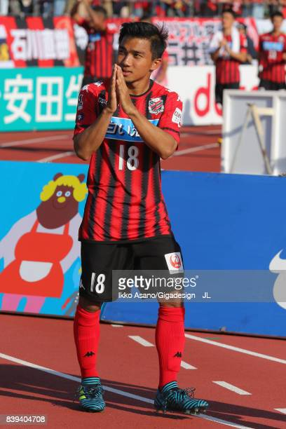 Chanathip Songkrasin of Consadole Sappporo applauds supporters after his side's 10 victory in the JLeague J1 match between Consadole Sapporo and...