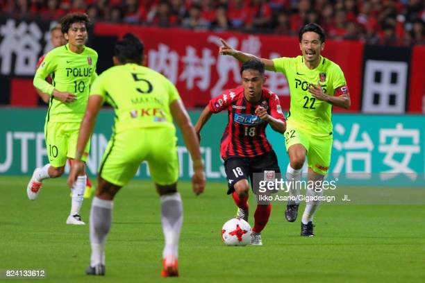Chanathip Songkrasin of Consadole Sappporo controls the ball under pressure of Urawa Red Diamonds defense during the JLeague J1 match between...