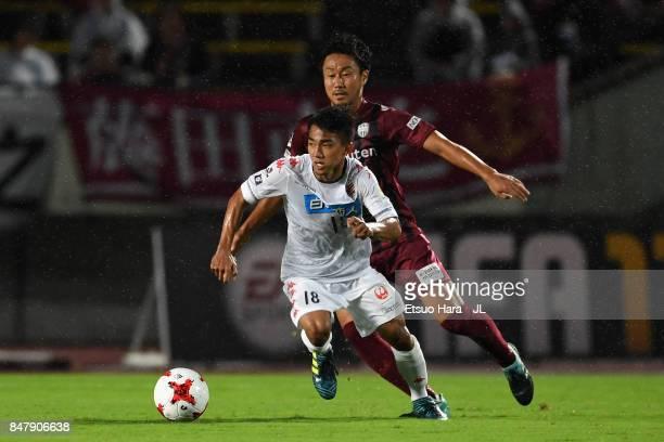 Chanathip Songkrasin of Consadole Sappporo controls the ball under pressure of Naoyuki Fujita of Vissel Kobe during the JLeague J1 match between...