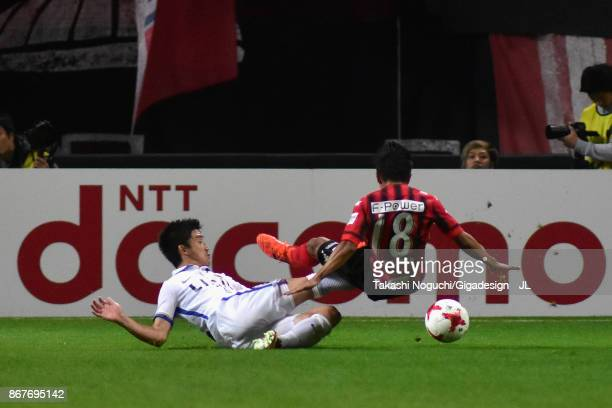Chanathip Songkrasin of Consadole Sappporo is tackled by Daigo Nishi of Kashima Antlers during the JLeague J1 match between Consadole Sapporo and...