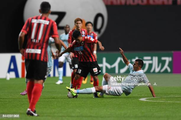 Chanathip Songkrasin of Consadole Sappporo is tackled by Fozil Musaev of Jubilo Iwata during the JLeague J1 match between Consadole Sapporo and...