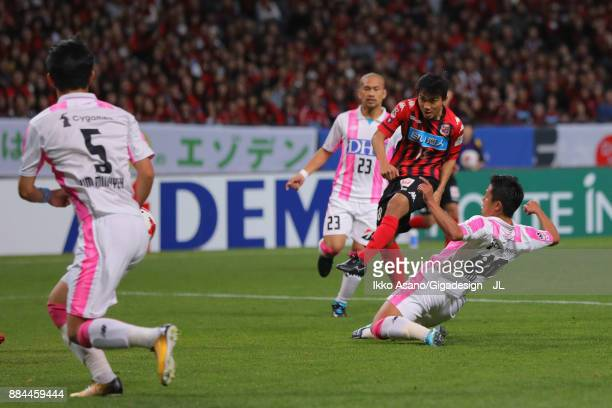 Chanathip Songkrasin of Consadole Sappporo shoots at goal during the JLeague J1 match between Consadole Sapporo and Sagan Tosu at Sapporo Dome on...