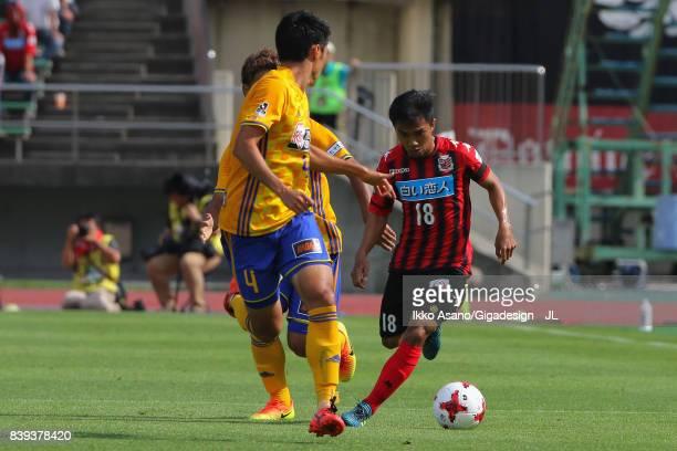 Chanathip Songkrasin of Consadole Sappporo takes on Koji Hachisuka of Vegalta Sendai during the JLeague J1 match between Consadole Sapporo and...