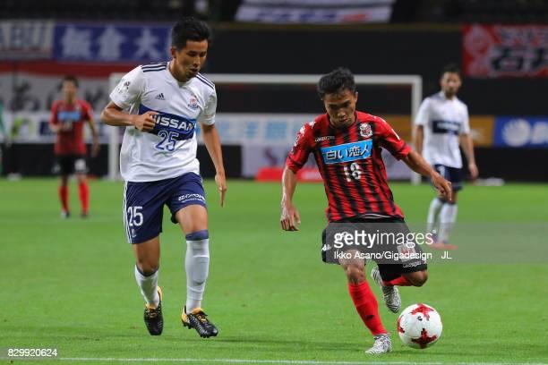 Chanathip Songkrasin of Consadole Sappporo takes on Naoki Maeda of Yokohama FMarinos during the JLeague J1 match between Consadole Sapporo and...