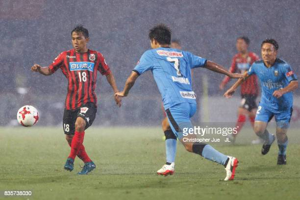 Chanathip Songkrasin of Consadole Sappporo takes on Shintaro Kurumaya of Kawasaki Frontale during the JLeague J1 match between Kawasaki Frontale and...