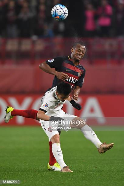 Chanathip Songkrasin of Muangthong United and Leo Silva of Kashima Antlers compete for the ball during the AFC Champions League Group E match between...