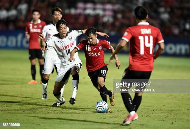 Chanathip Songkrasin of Muangthong United attempts to get past Nakamura Kengo of Kawasaki Frontale during the AFC Asian Champions League football...