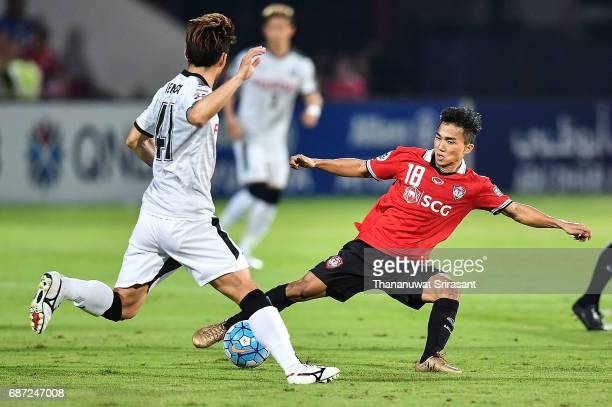Chanathip Songkrasin of Muangthong United competes for the ball during the Asian Champions League Group of 16 match between Muangthong United and...