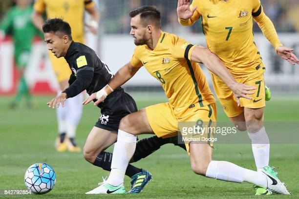 Chanathip Songkrasin of Thailand and Bailey Wright of the Socceroos compete for the ball during the 2018 FIFA World Cup Qualifier match between the...