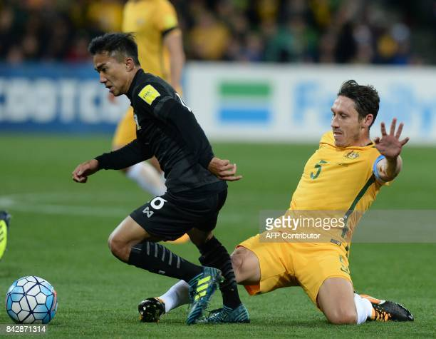 Chanathip Songkrasin of Thailand is challenged by Mark Milligan of Australia during the World Cup 2018 qualifying football match between Australia...