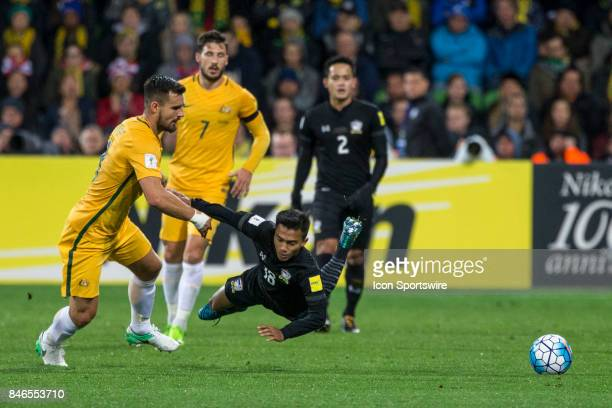 Chanathip Songkrasin of the Thailand National Football Team falls after a contest with Bailey Wright of the Australian National Football Team during...