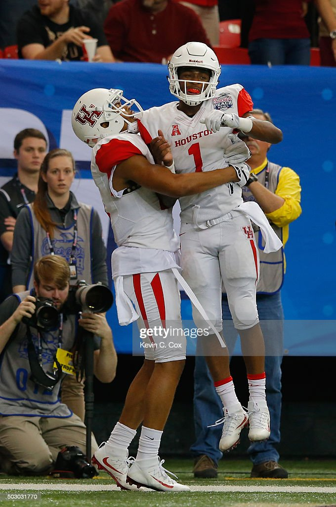 Chance Allen of the Houston Cougars celebrates his touchdown reception in the fourth quarter with teammate quarterback Greg Ward Jr #1 against the...