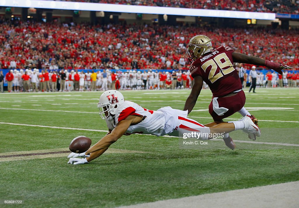 Chance Allen of the Houston Cougars fails to pull in a touchdown reception against Nate Andrews of the Florida State Seminoles in the fourth quarter...