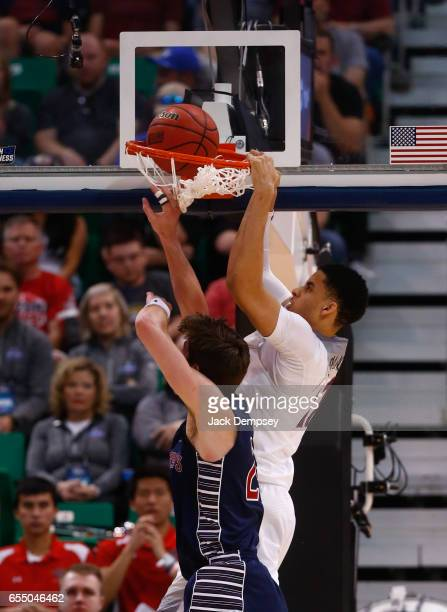 Chance Comanche of Arizona attempts to dunk the ball over Dane Pineau of St Mary's during the 2017 NCAA Men's Basketball Tournament held at Vivint...
