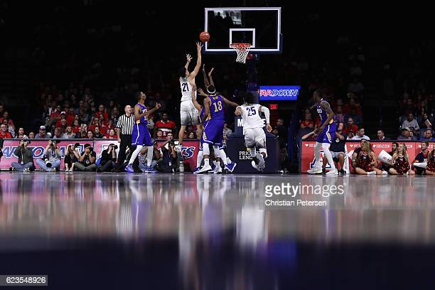 Chance Comanche of the Arizona Wildcats attempts a shot against the Cal State Bakersfield Roadrunners during the second half of the college...