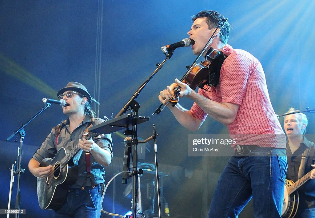 Chance McCoy, Ketch Secor, and Kevin Hayes of Old Crow Medicine Show perform at Verizon Wireless Amphitheater on May 17, 2013 in Alpharetta, Georgia.