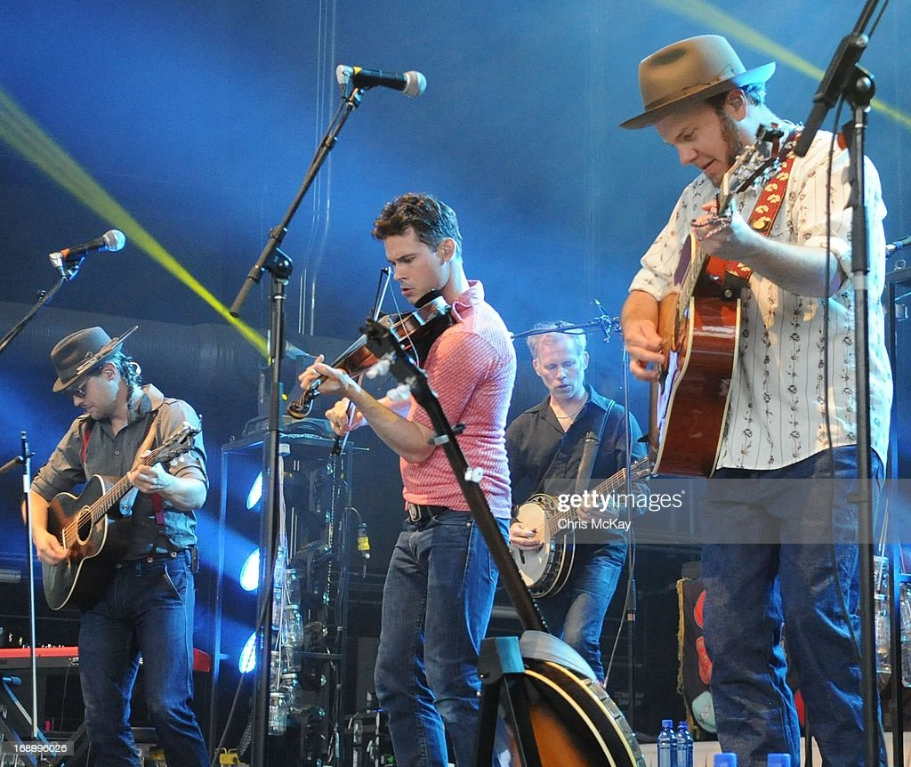 Chance McCoy, Ketch Secor, Kevin Hayes, and Critter Fuqua of Old Crow Medicine Show perform at Verizon Wireless Amphitheater on May 17, 2013 in Alpharetta, Georgia.