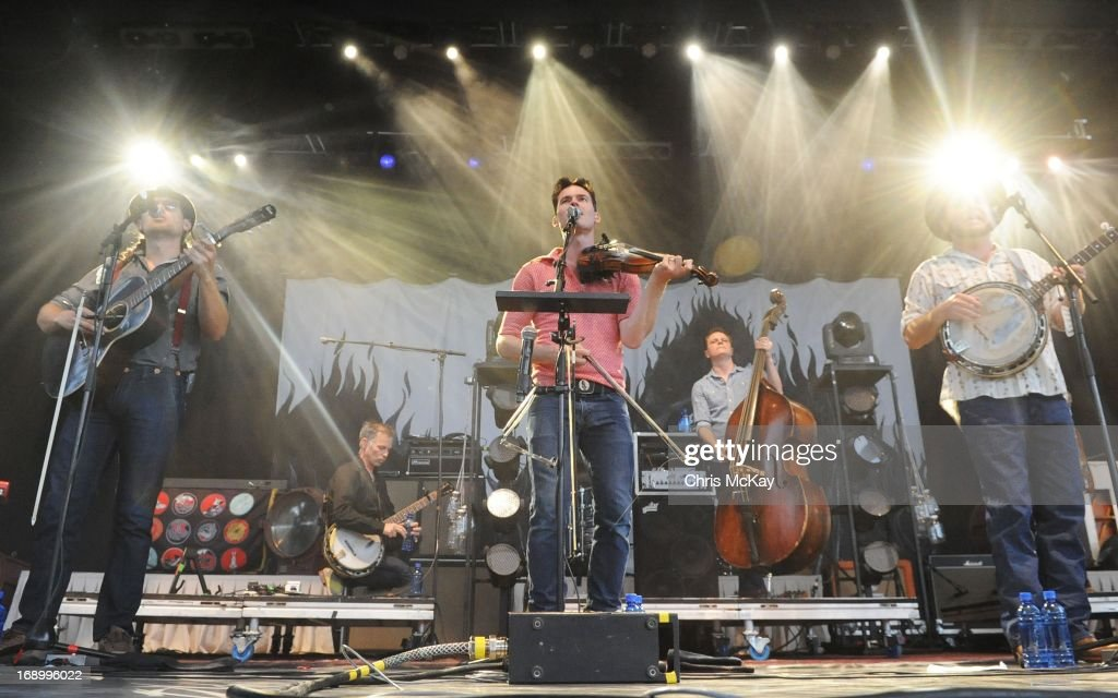 Chance McCoy, Kevin Hayes, Ketch Secor, Morgan Jahnig, and Critter Fuqua of Old Crow Medicine Show perform at Verizon Wireless Amphitheater on May 17, 2013 in Alpharetta, Georgia.
