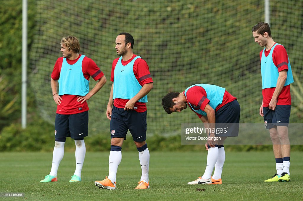 Chance Myers Landon Donovan Benny Feilhaber and Clarence Goodson of the US Men's National Soccer team take a break during training at StubHub Center...