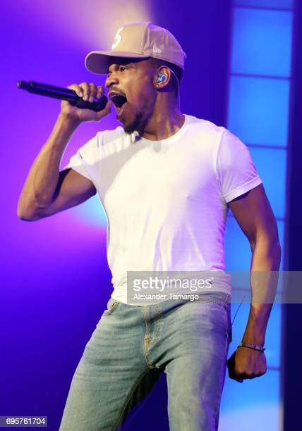Chance The Rapper is seen performing on stage during the Be Encouraged Tour at the AmericanAirlines Arena on June 13 2017 in Miami Florida