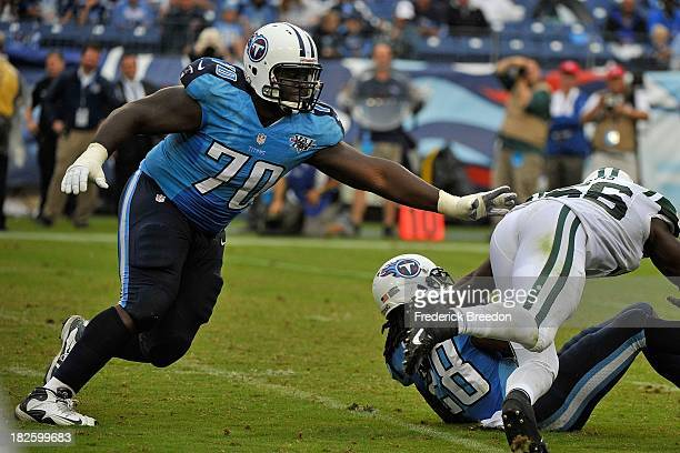 Chance Warmack of the Tennessee Titans blocks against the New York Jets at LP Field on September 29 2013 in Nashville Tennessee