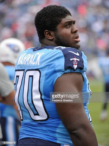 Chance Warmack of the Tennessee Titans watches from the sideline during a game against the Kansas City Chiefs at LP Field on October 6 2013 in...