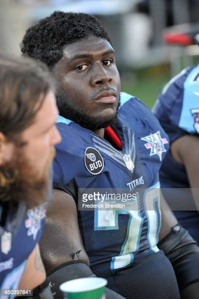 Chance Warmack of the Tennessee Titans watches from the sideline during a game against the Jacksonville Jaguars at LP Field on November 10 2013 in...